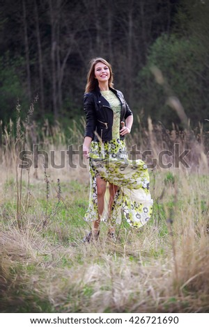 Portrait of a beautiful girl in a white dress outdoors jacket fashion style - stock photo
