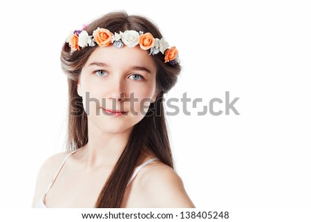 Portrait of a beautiful girl in a wreath