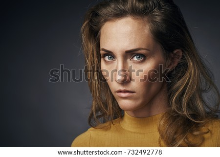 Portrait of a beautiful girl in a yellow sweater