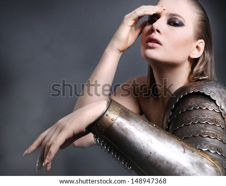 Portrait of a beautiful girl in armor - stock photo