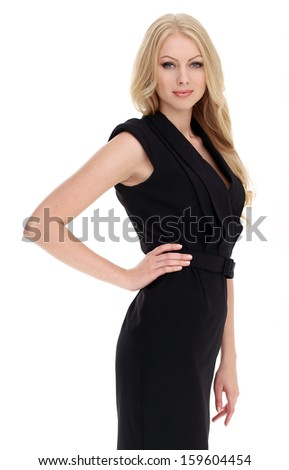 Portrait of a beautiful girl in black dress with blonde and curly hair who is posing over a white background - stock photo