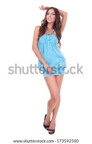 portrait of a beautiful girl in dress isolated on white background - stock photo