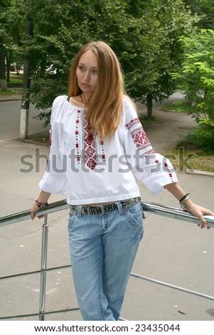portrait of a beautiful girl in folk style - stock photo
