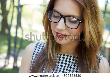 portrait of a beautiful girl in glasses close-up