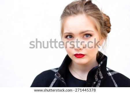 portrait of a beautiful girl in high key against a white wall - stock photo