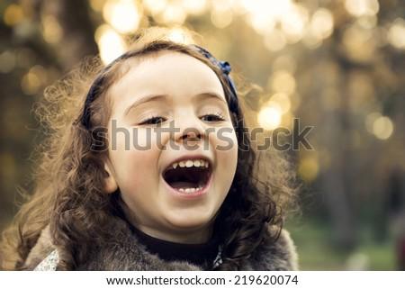 Portrait of a beautiful girl in outdoor enjoying the fall season - stock photo