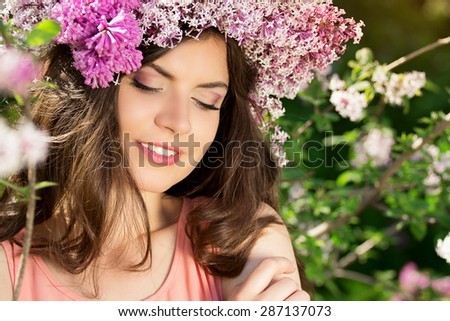 Portrait of a beautiful girl in pink with flowers