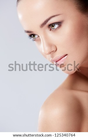 Portrait of a beautiful girl in studio - stock photo