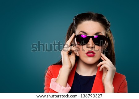 portrait of a beautiful girl in sunglasses