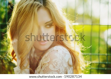 portrait of a beautiful girl in sunlight outdoor - stock photo