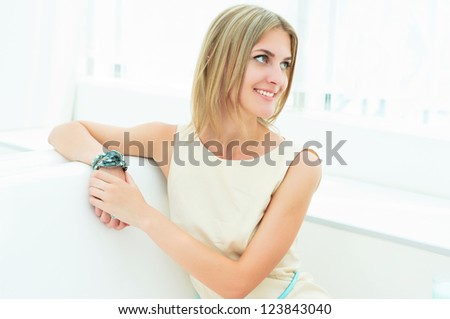 portrait of a beautiful girl in the cafe, enjoying life - stock photo