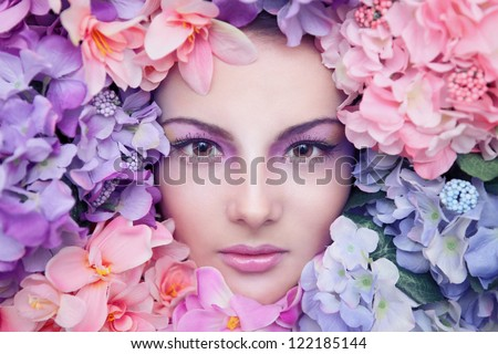 Portrait of a beautiful girl in the flowers - stock photo