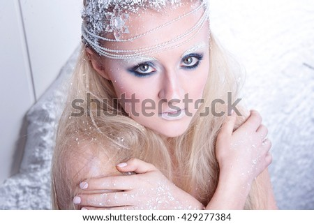 Portrait of a beautiful girl in the frost