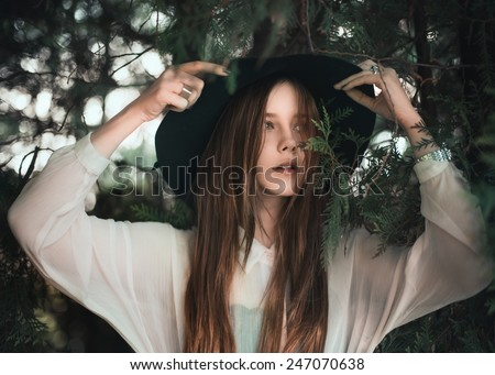 portrait of a beautiful girl in the hat close-up - stock photo