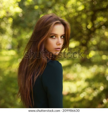 portrait of a beautiful girl in the park - stock photo