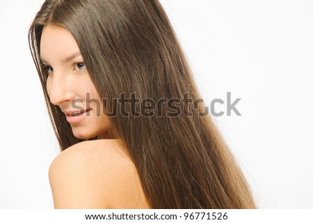 portrait of a beautiful girl in the studio on a white background with long hair on the shoulders