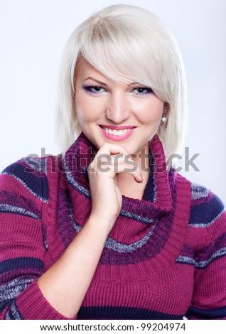 Portrait of a beautiful girl in woolen sweater - stock photo