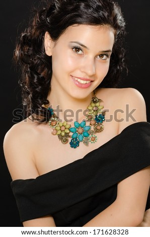 portrait of a beautiful girl on a black background