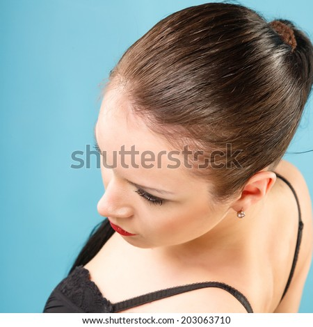 Portrait of a beautiful girl on a blue background - stock photo