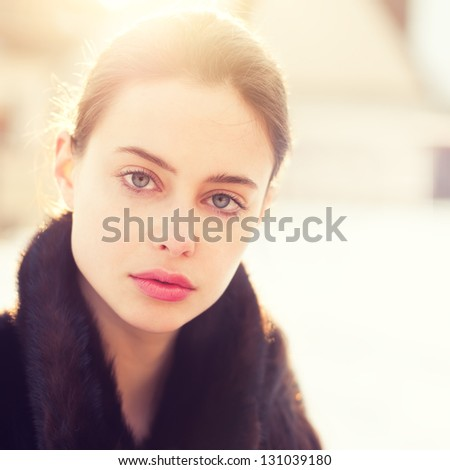 portrait of a beautiful girl on a sunny spring day - stock photo