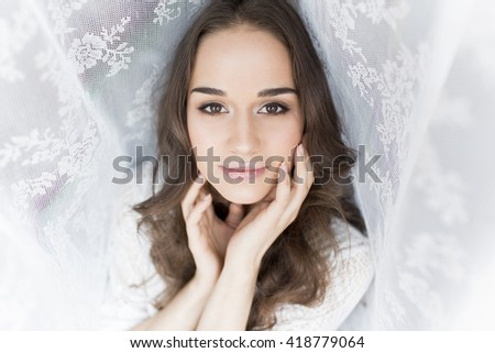 Portrait of a beautiful girl on a white background emotions - stock photo