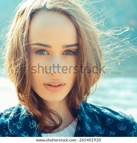 portrait of a beautiful girl on a  windy day. Art portrait of a beautiful lonely girl - stock photo