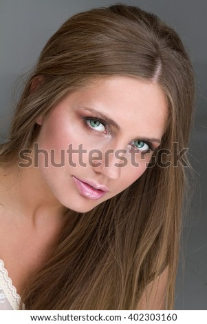 portrait of a beautiful girl on dark background in studio