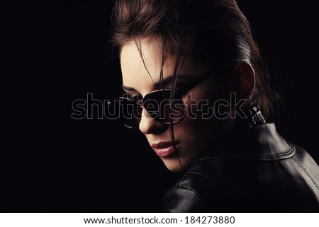 Portrait of a beautiful girl on glasses. - stock photo
