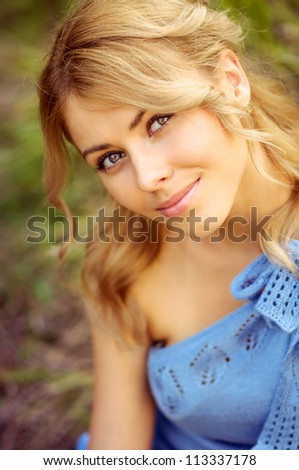 portrait of a beautiful girl on the outside - stock photo