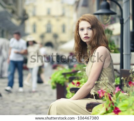 portrait of a beautiful girl on the streets of the beautiful city - stock photo