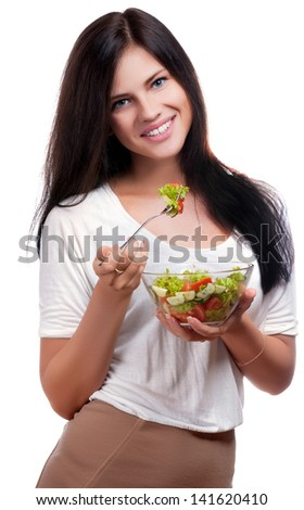 Portrait of a beautiful girl smiling and ready to eat a bowl of fruit salad - stock photo