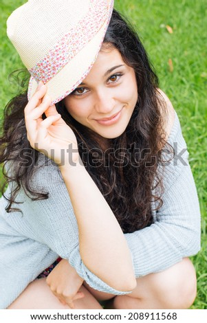 Portrait of a beautiful girl smiling with a straw hat