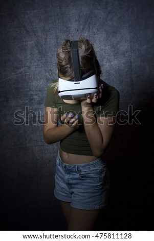 Portrait of a beautiful girl using VR glasses