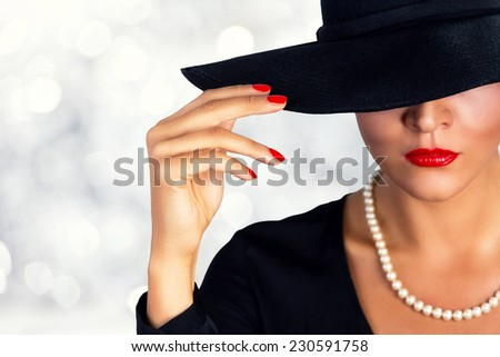 Portrait of a beautiful girl wearing black hat. - stock photo
