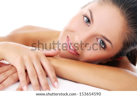 Portrait of a beautiful girl who is lying on her arms - stock photo