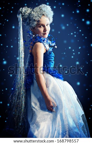 Portrait of a beautiful girl who looks like a little snow Queen.