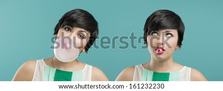 Portrait of a beautiful girl with a bubble gum on the mouth, against a blue background - stock photo