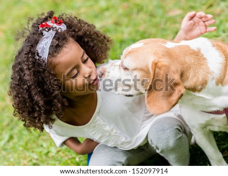 Portrait of a beautiful girl with a cute dog  - stock photo