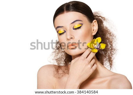Portrait of a beautiful girl with a flower orchid