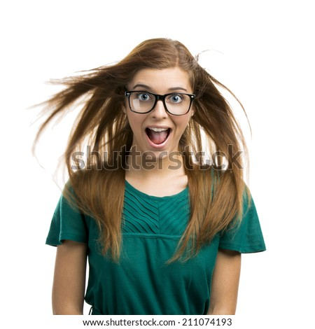 Portrait of a beautiful girl with a happy expression isolated on white background