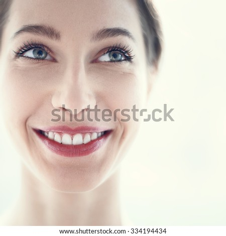 portrait of a beautiful girl with a sexy smile close up - stock photo