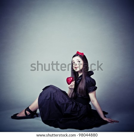 portrait of a beautiful girl with an apple - stock photo