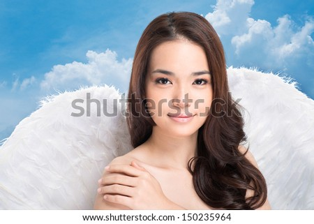Portrait of a beautiful girl with angel wings - stock photo