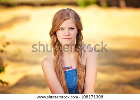 portrait of a beautiful girl with blue eyes - stock photo