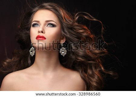 Portrait of a beautiful girl with curly hair - stock photo