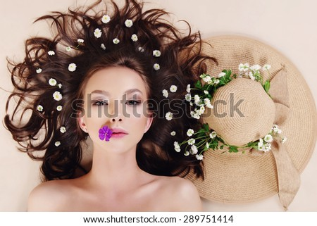 Portrait of a beautiful girl with flowers in her hair, spa concept - stock photo