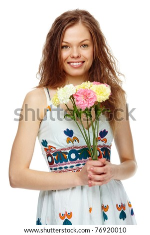 Portrait of a beautiful girl with flowers looking at camera and smiling - stock photo