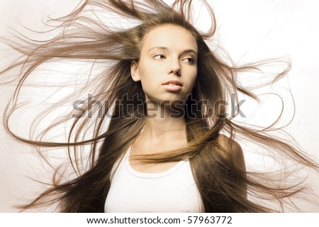 Portrait of a beautiful girl with flying hair