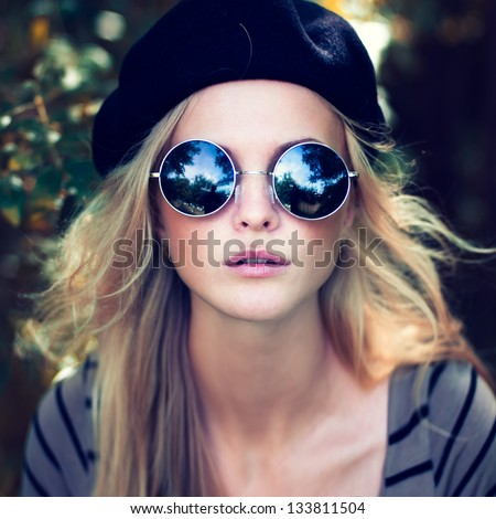 portrait of a beautiful girl with glasses - stock photo