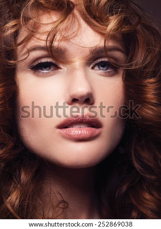 Portrait of a Beautiful Girl With Healthy Long Red Hair. Wavy Hair.Hairstyle. Make-up. Hairdressing.